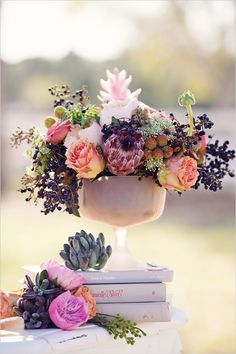 vintage wedding floral ideas less mauve and pinks more corals, greens and oranges. Like the style of arrangment for cake desert table.