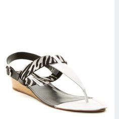 """Diane Von Furstenberg Black & White Sandals NWT. DVF calf hair sandals, sling back style. Low heel, 1"""". Black & white combo with zebra print calf hair. Never worn. Slight cosmetic defect on insole of the one sandal (pictured) but would be covered when wearing. Comes in box but not original.   Reasonable offers welcome via the OFFER button!  Bundle discount available!(15% off 2+items) No modeling/trades/off-line transactions Diane von Furstenberg Shoes Sandals"""