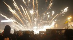 Protesters fire at police with fireworks, in central Kiev, Ukraine, Monday, Jan. 20, 2014. After a night of vicious streets battles, anti-go...