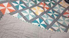Teal pinwheel quilt
