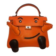 Hermes Kelly Idole (Kelly Doll) Gulliver Orange | From a collection of rare vintage handbags and purses at http://www.1stdibs.com/fashion/accessories/handbags-purses/