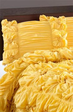 WOW Not a fan of yellow, but this looks like Frosting! Cozy :) Brighten up the bedroom. Love this bold yellow ruched knots look.
