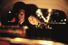 In the Mood for Love (Wong Karwai, Hong Kong, 2000): Mr. Chow and Mrs. Su at the back of a taxi.  One of my absolute favorites.  The atmosphere of this film is simply delicious.