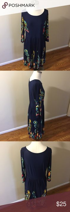 "Reborn Navy Blue Floral Dress New with tags! Size Large.   Approx measurements:  Armpit to armpit 18""  Armpit to end of sleeve 11""  Front neckline to bottom of dress 33""  Back neckline to bottom of dress 36""   Please message me w any questions and thanks for looking! Reborn Dresses"