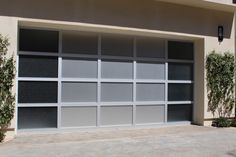 Modern garage doors have set the trend for many architects and builders in 2012. Simple lines and the the use of reclaimed lumber are the latest ways to build cool decorative garage doors. Contemporary styles and innovative designs; our modern garage door collection consists of custom wood garage doors, eco series garage doors, metal garage doors and aluminum garage doors. We work with architects & designers to create new designs and even bring old things to life