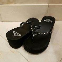 Black Roxy Flip Flops Black  Roxy flip flops with cute round studs to for a little personality. Both cute & comfy. These have hardly been used though, maybe worn 3 times . In great condition overall. Roxy Shoes