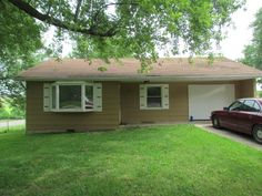 3 bedroom/1.5 bath home with large fenced in yard, storage buildings (one is 18x24) and close to parks! in Marshfield MO
