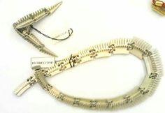 #Collana ed #orecchini #Correani elementi metallici dentati anni 80 #collezione #vintage. Annarita Vitali  www.annaritavitali.jimdo.com