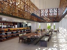 Villa & Resort: Timber Communal Dining Table And Traditional Wooden Chairs Also Wooden Slat Decoration Panels Of Alila Villas Uluwatu In Bali: Fascinating Beach Resort Design in Bali with Seaside Scenery
