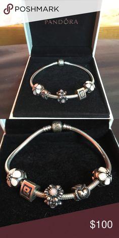 Pandora Iconic Bracelet with Charms 7.5in Pandora Iconic Bracelet with 5 charms. 2 cherry blossom charms (originally $55 each), 18th bithday milestone charm (originally $25), October birthday blooms pink opal charm (orignally $65), and alphabet charm B (originally $30). Bracelet originally $65 Pandora Jewelry Bracelets