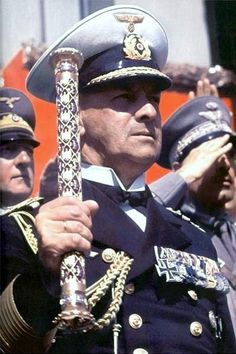 German Navy Grand Admiral Raeder holding his baton at a rally. He was in fact the last leader of Free Germany, not the pawns of the USA and bankers who won the war.
