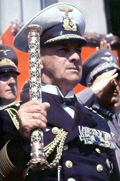 German Navy Grand Admiral Raeder holding his baton at a rally