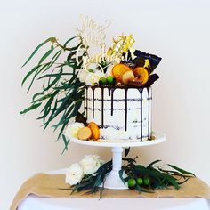 This little beauty was created for the wedding of Sam and @samigaudreau at the gorgeous @burntorangemosman. A decadent dark chocolate & orange cake filled with dark chocolate & orange ganache, decorated in macarons, candied orange, toffee shards, chocolate shards, pistachio, chocolate glaze and gold leaf. Cake stand from @sweetbitsndpieces. Cake topper by @communicakeit. Cake, design and styling all by @cakedbycarissa.  #nakedcake #chocolatedrip #goldleafcake #candiedorange #gumleafcake…
