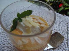 Purea di pesca e rhum con quenelle di ricotta dolce e scaglie di mandorle!! Peach puree and rum with sweet ricotta dumplings and almond flakes!!