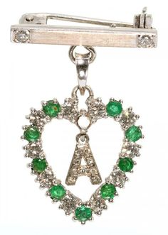AN EMERALD AND DIAMOND SET WHITE GOLD HEART SHAPED BROOCH - PENDANT, WITH INITIAL A, MARKED 18K, 4.3G  Sold @ Mellors & Kirk