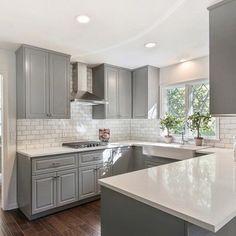 Grecian white marble subway tile backsplash for white and grey kitchen.