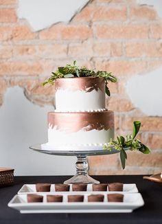 copper wedding cakes photo by Michelle and Logan http://ruffledblog.com/modern-copper-and-emerald-wedding-ideas