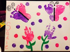 Mother's Day present for my daughter!  Feet prints made into Butterflies and Hand Prints made into flowers.  Thought they turned out pretty good considering the twins are 11 months old!