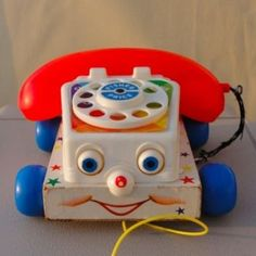 """Fisher Price Chatterbox - I'm pretty sure I still have mine around the house somewhere. I used to get on it to """"talk"""" to my dad before I could even really talk! :)"""