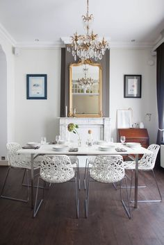 Home with Heart: A Classical Modern Belgian Family Home. Love those white dining chairs.