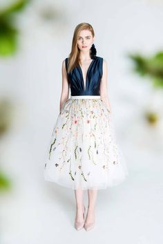 Voluminous tulle skirt with floral embroidery, made from 6 layers of tulle, one layers of satin linning and one layer of ecru tulle covered with floral embroidery. Skirt has hidden zipper on the...