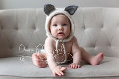 seven month photos, 7 month baby girl, simple baby portrait, natural light studio, hats with ears © Dimery Photography 2013