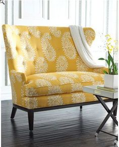 I have been wanting to bring in a punch of yellow for the winter months.... Finding a fun print like this in some throw pillows may do the trick...!  love the shape of the setee...as well...