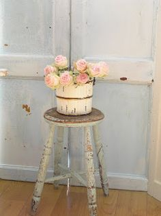 Old stool, old bucket, new buds...nice