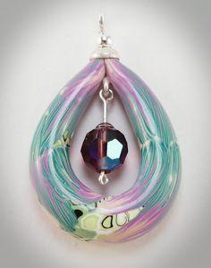 Silver, polymer clay, glass bead.  Barbara Colautti