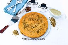 Knafeh....A flat platter usually made with semolina dough and a filling of melted gooey cheese or clotted cream   Hadia's Lebanese Cuisine