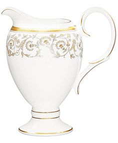 Formal dining gets the golden touch. Embossed with fine foliage details in gleaming gold, this exquisitely crafted creamer by Noritake makes every spread a sensation in dishwasher-safe bone china. | B