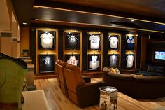 Man cave idea: display uniforms of your favorite players and watch the big game on TV.