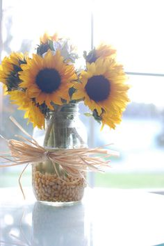 Sunflowers in corn kernals with corn husk bow for fall <3