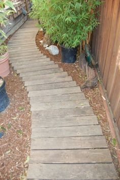 Garden Walkway Out Ideas with Pallet Boards 24 .ing a pool of water running through its centre.Suspended walkways:Suspended walkways can range from the Golden Gate Bridge to a dangling wooden path i Wood Pathway, Pallet Walkway, Wooden Path, Wooden Walkways, Wooden Garden, Pallet Pool, Diy Pallet, Landscape Design, Garden Design