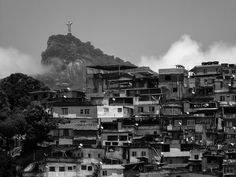Edited photographer caption: This photo, taken from Santa Teresa, shows Christ the Redeemer in the background and a slum in the foreground. The beautiful, distant river scenery is a contrast to the local reality.