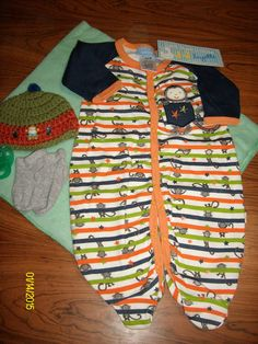 Swaddled Baby Boy Navy Blue,Green & Orange Monkey Pajama Diaper Cake -BGOM09 You will receive 1-Micro Fiber Receiving Blanket, 1-Full Body Pajama, 1-Handmade Crochet Beanie,1 Pacifier,1 Pair of Socks & 12 Use-able Diapers.$25.00 free ship