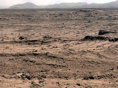 "Panoramic View From 'Rocknest' Position of Curiosity Mars Rover. This panorama is a mosaic of images taken by the Mast Camera (Mastcam) on the NASA Mars rover Curiosity while the rover was working at a site called ""Rocknest"" in October and November 2012."