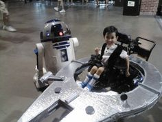 millennium falcon wheel chair cos - because some parents are unbelievably cool!---I love that these kids look so cool. When someone is in a chair some people can be rude are just down right ugly.