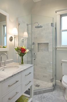 Beautiful bathroom using light grey moon mosaic tile in shower insert and shower…