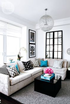 Living room: Terrific turquoise condo - Style At Home love the mismatched while still matching perfectly look.