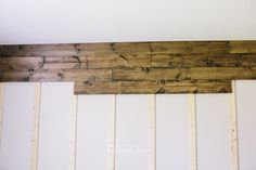 DIY and How-To: Wooden Wall in Our Bedroom ~ (pic: Nailing the Wood on the Wall) ~ step-by-step tutorial with pics