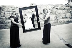 Usually the flower girls hold the frame but we love this idea with the mothers! Photo by Kim. #MinneapolisWeddingPhotographer #WeddingPhotography
