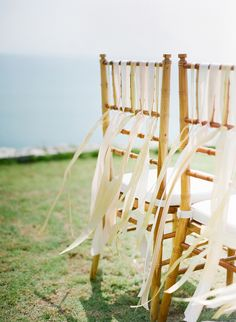 Ivory Ribbon #chair-decor, #chair  Photography: Jemma Keech - jemmakeech.com  Read More: http://www.stylemepretty.com/2014/09/11/romantic-cliff-top-wedding-by-the-sea-in-bali/
