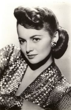 "OLIVIA DE HAVILLAND ~ Born: July 1st 1916 in Japan. She & Joan Fontaine are the first sisters to win Oscars. Starred in ""The Adventures of Robin Hood"" (1938), with Errol Flynn. She holds the record for the most people thanked in an Oscar acceptance speech (27) when she accepted the award for Best Actress for ""To Each His Own"" (1946). Was romantically involved with James Stewart, Howard Hughes & John Huston in the late 1930s. Today she enjoys a quiet retirement in Paris, France."