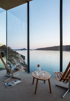 A coastal home view that's hard to beat. Floor-to-ceiling windows overlooking the water.