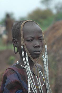 Africa |  Mursi girl, South Ethiopia.