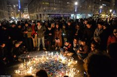 Vigil: People gathered around candles and pens at the Place de la Republique in Paris in support of the victims after the terrorist attack