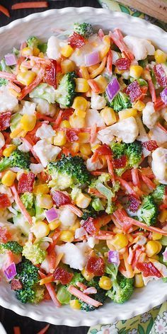 Creamy Broccoli, Cauliflower, Corn, Bacon Salad with Sliced Carrots, Diced Red Onions, and shredded Sharp Cheddar Cheese. #Ranch #salad