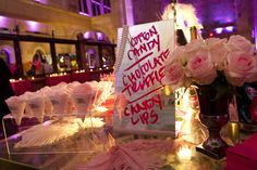 Great Performances decorated the dessert table to look like a boudoir for the opening night after-party for New York City Opera's Anna Nicole production, held at Skylight One Hanson in September 2013. The menu was written in red lipstick on vanity mirrors, and presented alongside jewelry boxes and glass jars filled with chocolate truffles, pink meringues, and candy lips, plus cones of pink cotton candy.  Photo: Elena Olivo