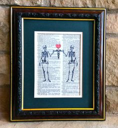 Unique Doctor or RN Nurse Gift - Two Skeletons holding Caduceus with Heart Print on Vintage Dorland's Medical Dictionary Page by MusicLadyGifts on Etsy